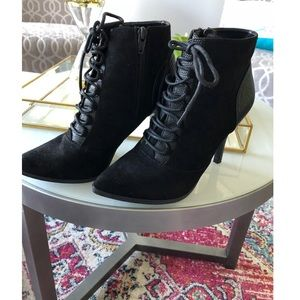 Leather and suede heel booties.